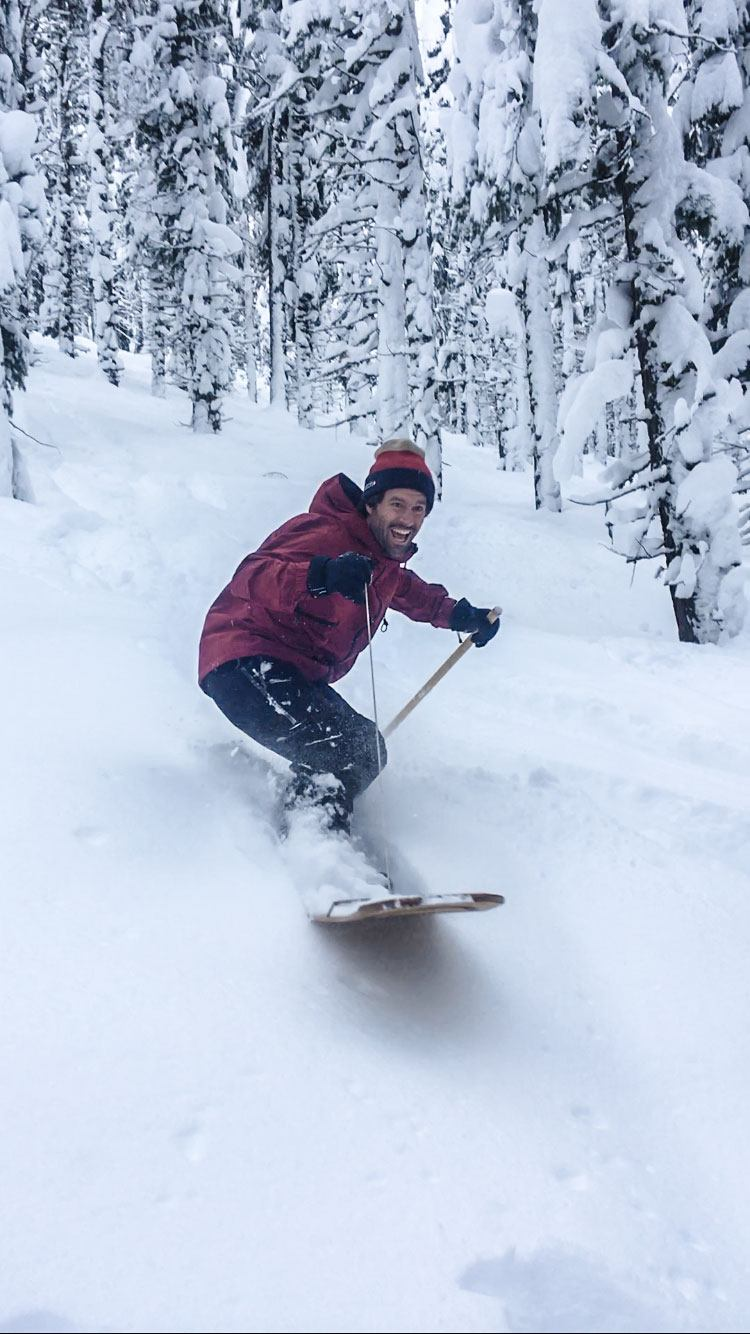 Snowboarder riding down hill